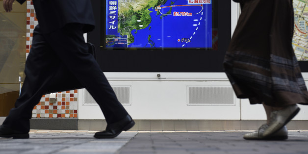 Pedestrians walk past a television screen displaying a map of Japan and the Korean Peninsula in a news program reporting on North Korea's missile launch in Tokyo, Japan, on Friday, Sept. 15, 2017. North Korea fired its second missile over Japan in as many months, a fresh provocation that comes shortly after the United Nations approved harsher sanctions againstKim Jong Uns regime. Photographer: Akio Kon/Bloomberg via Getty Images