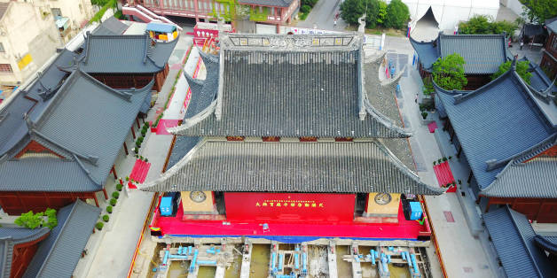 SHANGHAI, CHINA - SEPTEMBER 06:  Aerial view of the main hall of Jade Buddha Temple (aka Yufo Temple) moved horizontally on September 6, 2017 in Shanghai, China. The main hall of Shanghai's Jade Buddha Temple will be entirely moved over 30 meters horizontally and more than 1 meter higher in order to enlarge the space between the halls and ensure the safety of wooden buildings.  (Photo by VCG/VCG via Getty Images)