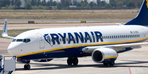 'Valencia, Spain - June 24, 2010: A Ryanair aircraft taxis to the gate at the Valencia airport. Ryanair is Europe\\\'s largest low-cost carrier, the 2nd-largest airline in Europe in terms of passenger numbers and the largest in the world in terms of international passenger numbers.'