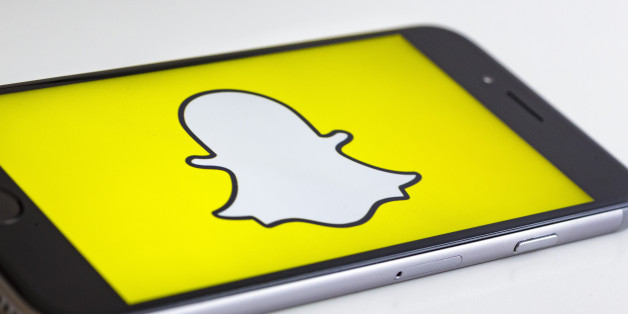 BERLIN, GERMANY - MAY 04: In this photo illustration the logo of Snapchat is displayed on a smartphone on May 04, 2017 in Berlin, Germany.  (Photo Illustration by Thomas Trutschel/Photothek via Getty Images)