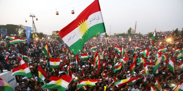 TOPSHOT - Iraqi Kurds fly Kurdish flags during an event to urge people to vote in the upcoming independence referendum in Arbil, the capital of the autonomous Kurdish region of northern Iraq, on September 16, 2017. / AFP PHOTO / SAFIN HAMED        (Photo credit should read SAFIN HAMED/AFP/Getty Images)