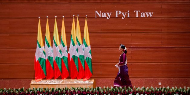 TOPSHOT - Myanmar's State Counsellor Aung San Suu Kyi arrives to deliver a national address in Naypyidaw on September 19, 2017.Myanmar leader Aung San Suu Kyi reached out to the global community on September 19 in a broad appeal for support over a refugee crisis the UN has decried as 'ethnic cleansing', urging outsiders to help her nation unite across religious and ethnic lines and offering a pathway back to the country for some of the Rohingya Muslims forced to flee by army operations. / AFP PH
