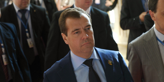 Russian Prime Minister Dmitri Medvedev (C) walks at the venue of the ninth Asia-Europe (ASEM 9) summit in Vientiane on November 6, 2012. The two-day bi-annual summit is being held in the capital of the Southeast Asian landlocked communist nation between November 5-6. AFP PHOTO / HOANG DINH Nam        (Photo credit should read HOANG DINH NAM/AFP/Getty Images)