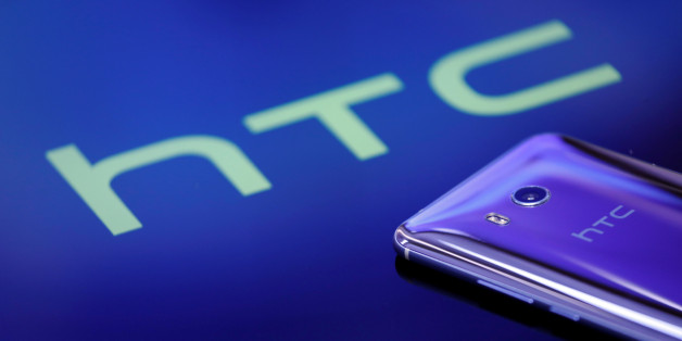 """A HTC """"U11"""" smartphone is displayed in this illustration photo taken August 1, 2017. REUTERS/Tyrone Siu/Illustration"""