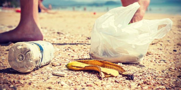 Vintage instagram style picture of garbage left by tourists on a beach, environmental pollution concept picture.