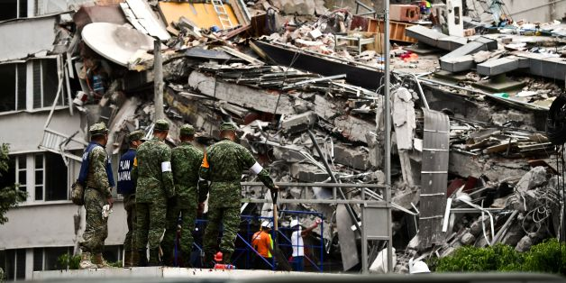 Rescuers search for survivors amid the rubble from a building flattened by the 7.1-magnitude quake the day before, in Mexico City, on September 20, 2019.  