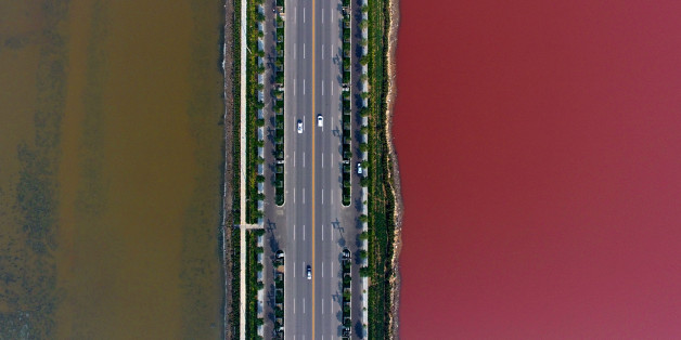 YUNCHENG, CHINA - OCTOBER 02:  Aerial view of the colorful salt lake on October 2, 2016 in Yuncheng, Shanxi Province of China. The salt lake displaying red and green colors in Yuncheng attract tourists during the National Day holiday. Formed about 500 million years ago, the salt lake owns different colors as a result of the algae in the water.  (Photo by VCG/VCG via Getty Images)