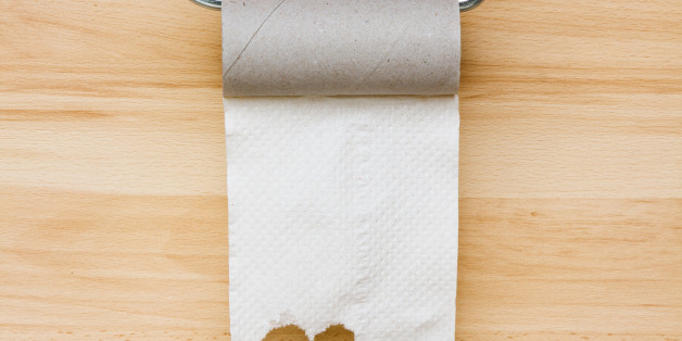 Toilet paper on wooden background. Empty space for text