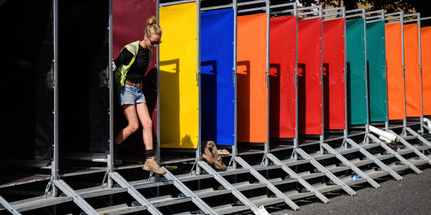 LONDON, ENGLAND - AUGUST 25:  A woman helps build some of the hundreds of portable toilets, ahead of the Notting Hill carnival, on August 25, 2017 in London, England. The Notting Carnival has been held annually since 1966 and sees performers and samba bands travel from across the world to take part. Floats at this years carnival will pay their respects to those killed in the Grenfell Tower fire by turning off their music as they pass through a quiet zone near to the remains of the hig-rise tower block.  (Photo by Leon Neal/Getty Images)