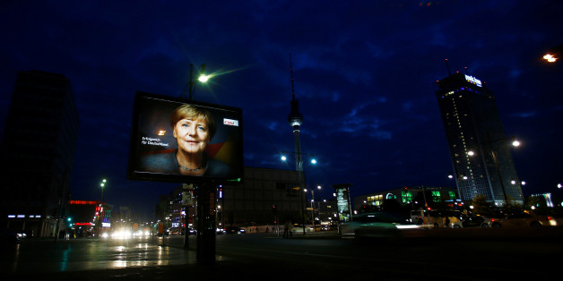 An election campaign poster for the upcoming general elections of the Christian Democratic Union party (CDU) with a headshot of German Chancellor Angela Merkel is displayed at Alexanderplatz square in Berlin, Germany, September 21, 2017. REUTERS/Hannibal Hanschke