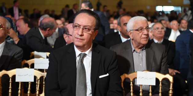 Hafedh Caid Essebsi (C), leader of Nidaa Tounes party, looks on as he attends an official speech delivered by the Tunisian President Beji Caid Essebsi (unseen) on May 10, 2017 in Tunis.