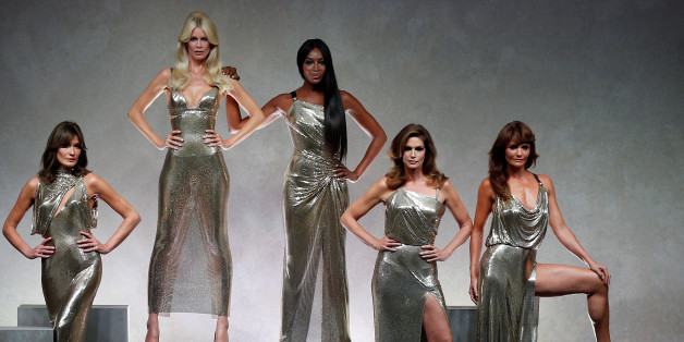 Former top models Carla Bruni (L), Claudia Schiffer, Naomi Campbell, Cindy Crawford and Helena Christensen display iconic  creations of late Italian designer Gianni Versace's during the Versace Spring/Summer 2018 show at the Milan Fashion Week in Milan, Italy, September 22, 2017. REUTERS/Stefano Rellandini