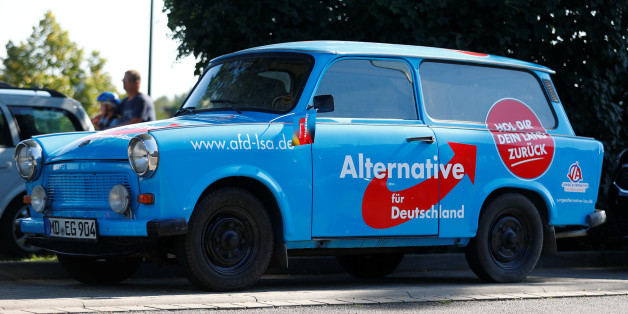 An AfD Party campaign Trabant car is seen before an election campaign rally of German Chancellor Angela Merkel, top candidate for the upcoming general elections of the Christian Democratic Union party (CDU), in Bitterfeld-Wolfen, Germany, August 29, 2017. REUTERS/Hannibal Hanschke