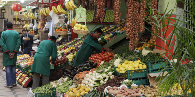 Vendors sell fruits and vegetables at a market in Rabat January 15, 2013. The alleys of Rabat's old city resound with the shouts of street vendors advertising Chinese consumer goods such as fabrics and electronic gadgets. But the area's vegetable sellers, from whom many residents buy dinner on the way home, are unusually quiet. Morocco's cash-strapped government is preparing to launch its biggest economic policy change in years: root-and-branch reform of the system of food and energy subsidies w