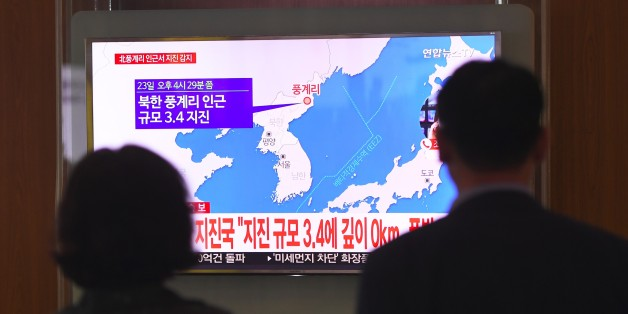 People watch a television news screen showing a map of the epicenter of an earthquake in North Korea, at a railway station in Seoul on September 23, 2017.