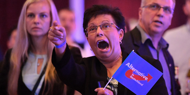 Supporters of the Alternative for Germany (AfD) react after exit poll results were broadcasted on public television at an election night event in Erfurt, eastern Germany during the general election on September 24, 2017. The Alternative for Germany (AfD) became the first hard-right, openly anti-immigration party to enter parliament in force since World War II, breaking a taboo despite mainstream parties' calls to halt 'the Nazis' in their tracks. / AFP PHOTO / dpa / Martin Schutt / Germany OUT        (Photo credit should read MARTIN SCHUTT/AFP/Getty Images)