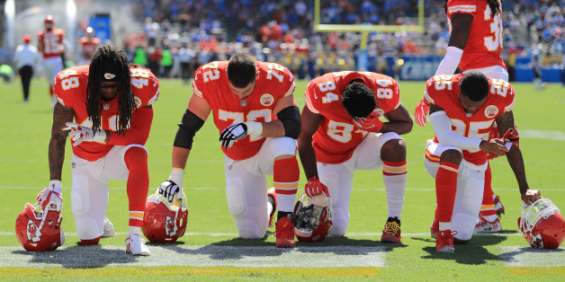 CARSON, CA - SEPTEMBER 24:  Terrance Smith #48, Eric Fisher #72, Demetrius Harris #84, and Cameron Erving #75 of the Kansas City Chiefs is seen taking a knee before the game against the Los Angeles Chargers at the StubHub Center on September 24, 2017 in Carson, California.  (Photo by Sean M. Haffey/Getty Images)