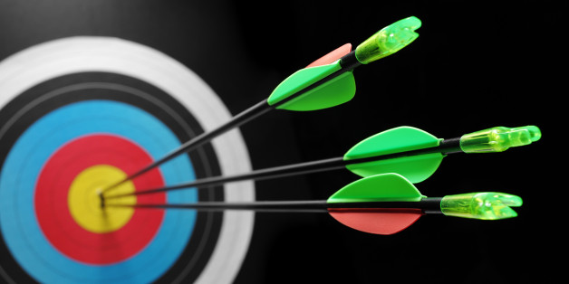 Three arrows in a target, scoring a bulls eye. Differential focus