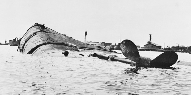 (Original Caption) Target Ship was Japs' Target. Washington, D.C.: The U.S.S. Utah is shown capsized following the Japanese attack on the Pearl Harbor, Hawaii, Naval Base on December 7. The old battleship was being used as a radio-controlled target ship by the Navy. The photo was released by the Navy department in Washington, D.C.