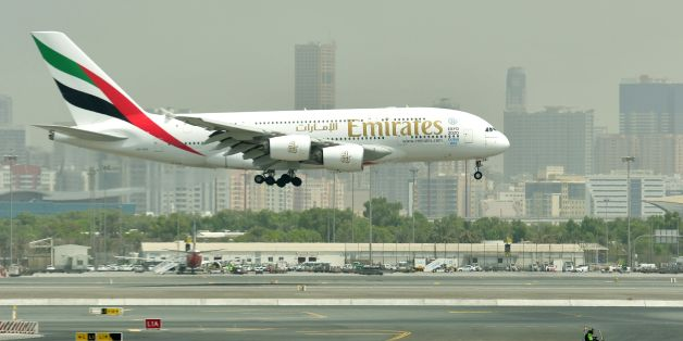 A picture take on September 14, 2017 shows an Airbus A380 of Emirates landing at the tarmac at Dubai's International Airport.  / AFP PHOTO / GIUSEPPE CACACE        (Photo credit should read GIUSEPPE CACACE/AFP/Getty Images)