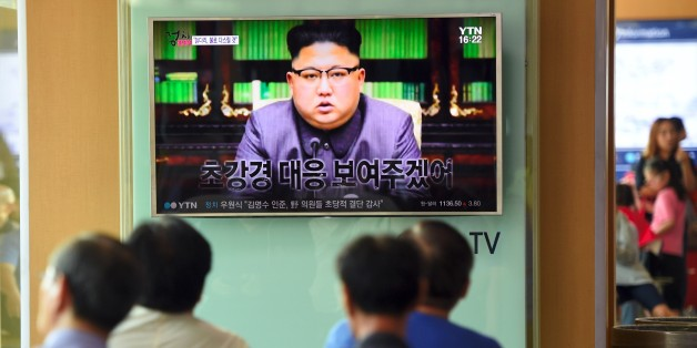 People watch a television news screen showing a picture of North Korean leader Kim Jong-Un delivering a statement in Pyongyang, at a railway station in Seoul on September 22, 2017. 