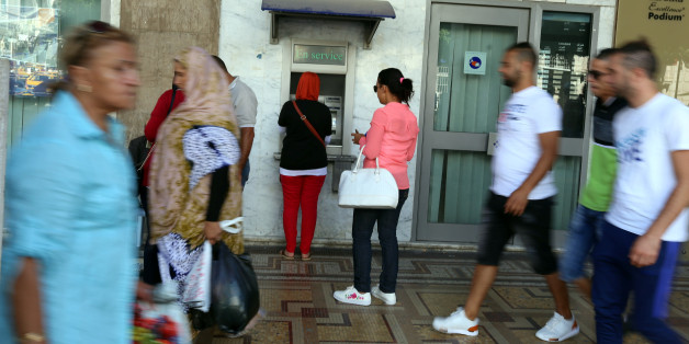 A woman uses a cash machine in downtown Tunis, Tunisia, September 21, 2017 REUTERS/Zoubeir Souissi