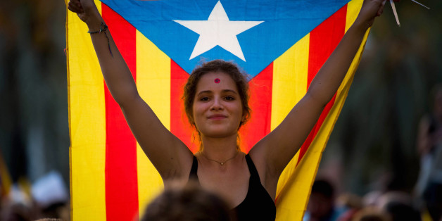 BARCELONA, SPAIN - SEPTEMBER 21:  A demonstrator holding a Catalan Pro-Independence flag 'Estelada' demonstrates in front of the Catalan High Court building on September 21, 2017 in Barcelona, Spain. Pro-Independence Associations called for a meeting in front of the Catalan High Court building demanding release of the 14 officials arrested yesterday during a Spanish Police operation in an attempt to stop the region's independence referendum, due to take place on October 1, which has been deemed