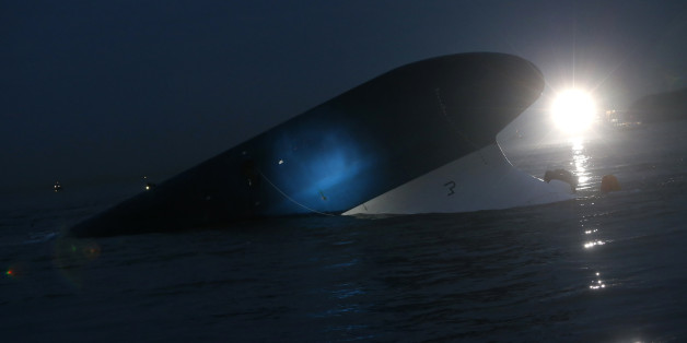 """South Korean ferry """"Sewol"""" is seen sinking at the sea off Jindo April 16, 2014. Almost 300 people were missing after a ferry capsized off South Korea on Wednesday, despite frantic rescue efforts involving coastguard vessels, fishing boats and helicopters, in what could be the country's biggest maritime disaster in over 20 years. REUTERS/Kim Hong-Ji (SOUTH KOREA - Tags: DISASTER MARITIME)"""