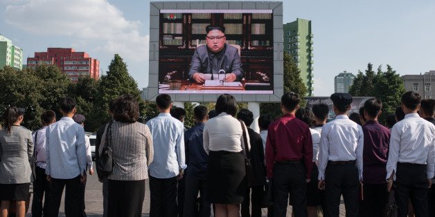 TOPSHOT - Spectators listen to a television news brodcast of a statment by North Korean leader Kim Jong-Un, before a public television screen outside the central railway station in Pyongyang on September 22, 2017.US President Donald Trump is 'mentally deranged' and will 'pay dearly' for his threat to destroy North Korea, Kim Jong-Un said on September 22, as his foreign minister hinted the regime may explode a hydrogen bomb over the Pacific Ocean. / AFP PHOTO / Ed JONES        (Photo credit shoul