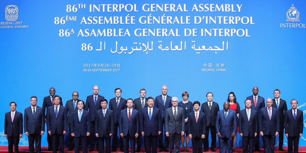 China's President Xi Jinping (front C), Interpol Secretary General Jurgen Stock (centre R) and Meng Hongwei (centre L), president of Interpol, pose for a group photo with various participants at the start of the 86th Interpol General Assembly at the Beijing National Convention Center in Beijing on September 26, 2017. The assembly is taking place in the Chinese capital from September 26 to 29. / AFP PHOTO / POOL / Lintao Zhang        (Photo credit should read LINTAO ZHANG/AFP/Getty Images)