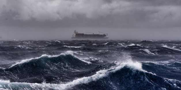 A cargo ship sails on the Mediterranean sea during a thunderstorm some 20 naughtical miles from Malta on September 24, 2017.  / AFP PHOTO / ARIS MESSINIS        (Photo credit should read ARIS MESSINIS/AFP/Getty Images)