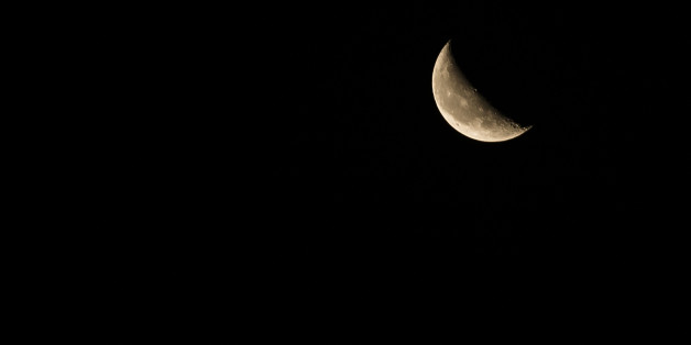 Crescent moon with dark sky background
