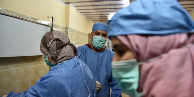 Algerian doctor Ahmed Bougroura (R), head of nephrology department at Batna's university hospital, 435 kms east of Algiers, talks to a transplanted patient on July 26, 2017.In Algeria and across the entire Maghreb in North Africa, many people continue to suffer or die because of the lack of donors. Part of the problem lies with laws restricting the harvesting of human organs, coupled with cultural or religious reticence, despite Muslim theologians' approval of organ donations. / AFP PHOTO / RYAD