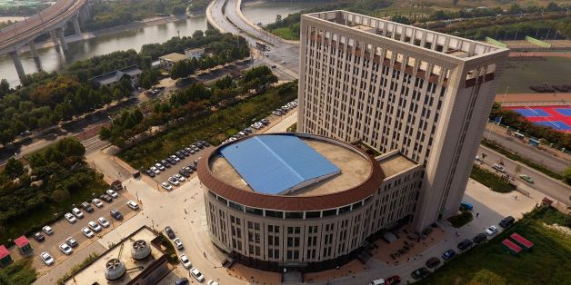 This photo taken on September 21, 2017 shows an aerial view of the buliding of the Career and Entrepreneurship Comprehensive Service Base of University Graduates in Zhengzhou in China's central Henan province. China has another entry when it comes to buildings that look suspiciously like something else -- a 12-storey block at a university strongly resembling a giant toilet. / AFP PHOTO / STR / China OUT        (Photo credit should read STR/AFP/Getty Images)