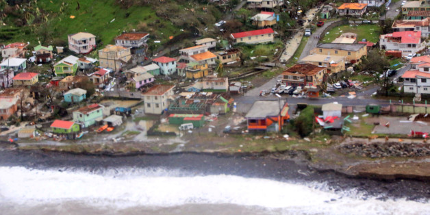 Damaged homes from Hurricane Maria are shown in this aerial photo over the island of Dominica, September 19, 2017.  Photo taken September 19, 2017.  Courtesy Nigel R. Browne/Caribbean Disaster Emergency Management Agency/Regional Security System/Handout via REUTERS    ATTENTION EDITORS - THIS IMAGE WAS PROVIDED BY A THIRD PARTY