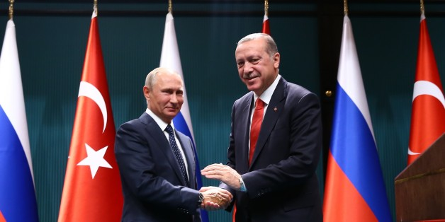 ANKARA, TURKEY - SEPTEMBER 28: Turkish President Recep Tayyip Erdogan (R) and President of Russia, Vladimir Putin (L) shake hands after holding a joint press conference following their meeting, at Presidential Complex in Ankara, Turkey on September 28, 2017. (Photo by Kayhan Ozer/Anadolu Agency/Getty Images)