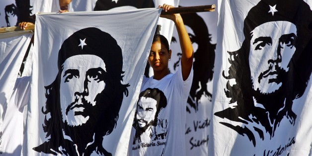 SANTA CLARA, CUBA - OCTOBER 8:  Cubans hold flags with the image of Che Guevara during a commemoration of the 40th anniversary of the death of Ernesto Che Guevara October 8, 2007 in Santa Clara, Cuba. Guevara was killed October 8, 2007 in Bolivia after being captured by CIA backed Bolivian soldiers. (Photo by Sven Creutzmann/Mambo photo/Getty Images)