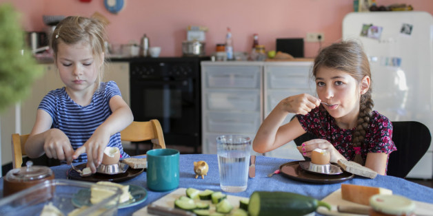 Bonn, Germany - August 07: A five and a seven-year-old girl are having breakfast together and eat boiled eggs on August 07, 2017 in Bonn, Germany. (Photo by Ute Grabowsky/Photothek via Getty Images)