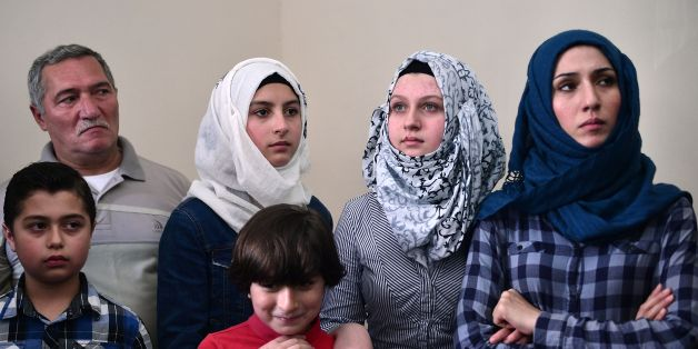 Members of a Syrian refugee family, wait for a visit of UN high commissioner for refugees, in an apartment where they live in Athens, rented to them by the United Nations High Commissioner for Refugees (UNHCR), on August 24, 2016. Samar, who fled Aleppo in Syria, lives in the apartment with her four children and her parents, Mohammad and Fatima, is waiting to be reunited with her husband who is currently elsewhere in Europe. More than 58,000 refugees and migrants are stranded in Greece with most of them living in refugee camps, while some 8,000 live in UNHCR arranged shelters, houses or hotels. / AFP / LOUISA GOULIAMAKI        (Photo credit should read LOUISA GOULIAMAKI/AFP/Getty Images)