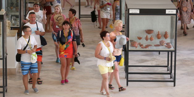 Tourists walk ,inside the Carthage Museum near Tunis, Tunisia July 31, 2017. Picture taken July 31, 2017. REUTERS/Zoubeir Souissi