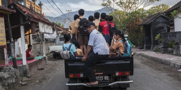Student evacuated from their home due to the volcanic activities of Mount Agung, on a car as they head of school in a temporary shelter in in Karangasem regency, Bali, Indonesia, on September 29, 2017.  Seismic activity below Mount Agung has been growing over recent weeks, with hundreds of tremors every day. Over the weekend, a plume of smoke has been seen rising from the crater. More than 134.000 people have fled the area around the crater and the alert was raised to the highest level on 22nd of September.  (Photo by Agoes Rudianto/NurPhoto via Getty Images)
