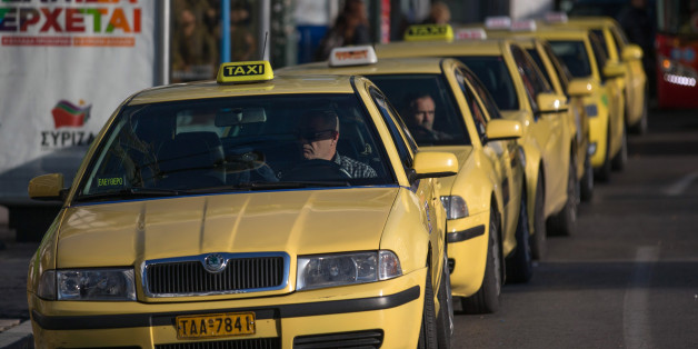 ATHENS, GREECE - JANUARY 26:  Taxi drivers wait for customers in Syntagma Square following the electoral success by Syriza in the Greek general election yesterday on January 26, 2015 in Athens, Greece.  The radical left party Syriza won the snap Greek general election and has asked the right-wing Independent Greek party to form a anti-austerity coalition.  (Photo by Matt Cardy/Getty Images)