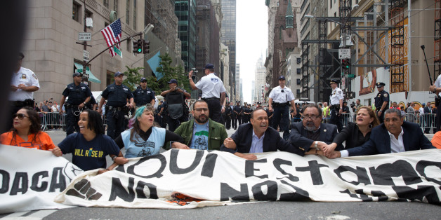 NEW YORK, NY - SEPTEMBER 19, 2017: Activists sit on Fifth Avenue in an action of civil disobedience near Trump Tower on September 19, 2017 in New York, New York. The action was intended to call attention to President Donald Trump's anti-immigration policies, including the rollback of DACA. (Photo by Kevin Hagen/Getty Images)