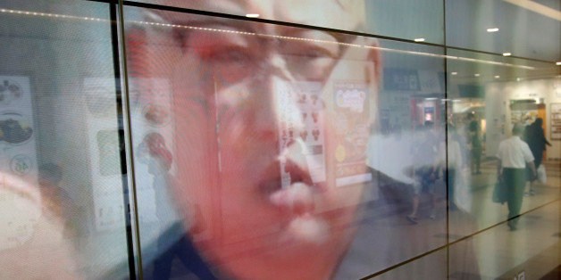 Passersby are reflected in a TV screen reporting news about North Korea's leader Kim Jong Un and their missile launch, in Tokyo, Japan, September 15, 2017.  REUTERS/Issei Kato