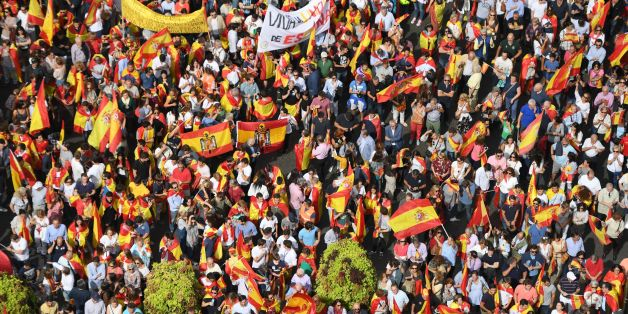 Protestors gather holding Spanish flags during a demonstration against independence of Catalonia called by DENAES foundation for the Spanish Nation Defence on September 30, 2017 in Madrid. Catalan separatists showed determination today to press ahead with an independence referendum banned by Madrid, occupying dozens of schools designated as polling stations to stop police from closing them down. / AFP PHOTO / GABRIEL BOUYS        (Photo credit should read GABRIEL BOUYS/AFP/Getty Images)