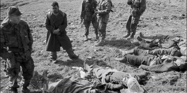 ALGERIA - MARCH: French soldiers, prisoner and dead bodies during 'Operation Bigeard' in March 1956, when an armed outbreak in Souk-Ahras, South of Constantine region, Algeria, led to the killing of nine French soldiers - Under the order of Colonel Bigeard, French troops, backed by twelve helicopters, launched the operation to counter the rebel strongholds in the more distant portions of the region. (Photo by REPORTERS ASSOCIES/Gamma-Keystone via Getty Images)