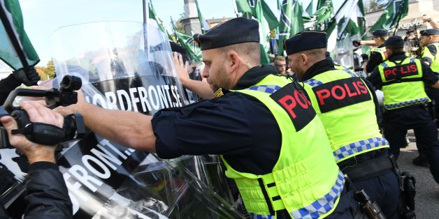 Police officers stop the far-right Nordic Resistance Movement march as it changed the planned route, on September 30, 2017 in Gothenburg, Sweden.  / AFP PHOTO / TT News Agency / Fredrik SANDBERG / Sweden OUT        (Photo credit should read FREDRIK SANDBERG/AFP/Getty Images)