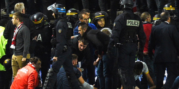 French police officers and members of the stadium staff gather to help LOSC's supporters following the fall of their tribune during the French L1 football match between Amiens and Lille LOSC on September 30, 2017 at the Licorne stadium in Amiens.