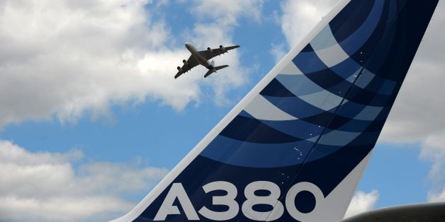 An Airbus A380 performs a flying display at Le Bourget airport, near Paris, on June 24, 2017 during the public days the International Paris Air Show. / AFP PHOTO / ERIC PIERMONT        (Photo credit should read ERIC PIERMONT/AFP/Getty Images)