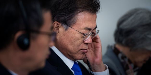South Korea's President Moon Jae-in listens to a statement before luncheon with US, Korean, and Japanese leaders at the Palace Hotel during the 72nd United Nations General Assembly September 21, 2017 in New York City. / AFP PHOTO / Brendan Smialowski        (Photo credit should read BRENDAN SMIALOWSKI/AFP/Getty Images)